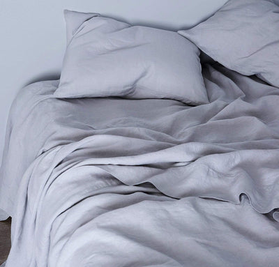 closeup detail of 100% linen flat sheet light grey color