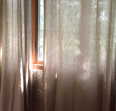 window with 100% linen curtains smooth airy lightweight linen slightly sheer natural un-dyed beige tan color