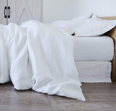 bedroom scene with 100% linen bed duvet comforter cover smooth texture lightweight linen fabric pure white color