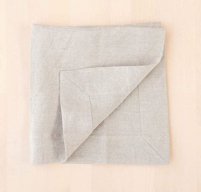 folded 100% linen napkin smooth texture lightweight linen fabric un-dyed natural beige color