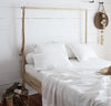 bedroom scene with 100% linen raw edge bed set with summer cover blanket pillow cases pure white color