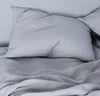 bedroom scene with 100% linen pillow slip cover light grey color