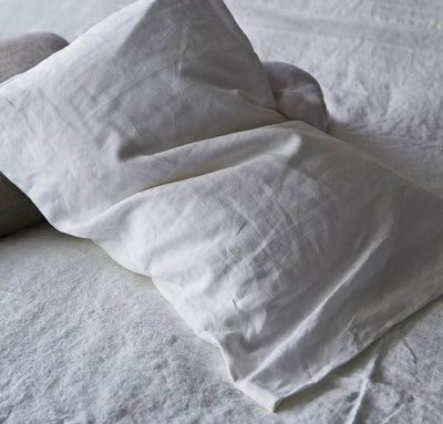 closeup detail of 100% linen pillow slip cover pure white color