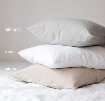stack of 100% linen pillow slip covers natural beige light brown tan pure white light grey colors