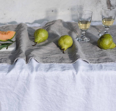 table with 100% linen table runner raw edge detail light grey color