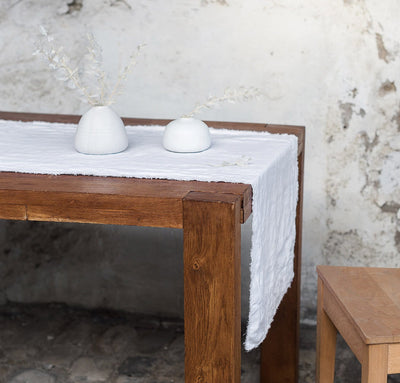 table with 100% linen table runner raw edge detail pure white color