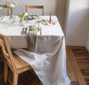dining table scene with 100% linen tablecloth smooth texture lightweight linen fabric pure white color