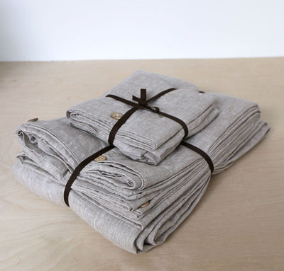folded stack of 100% linen bed-in-a-bag matching bed set including duvet comforter cover two pillow shams smooth texture mid-weight St. Barts linen fabric twin queen king calking sizes un-dyed natural taupe beige color