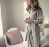 woman wearing 100% linen bathrobe unisex robe mid-weight St. Barts linen fabric un-dyed natural taupe beige color