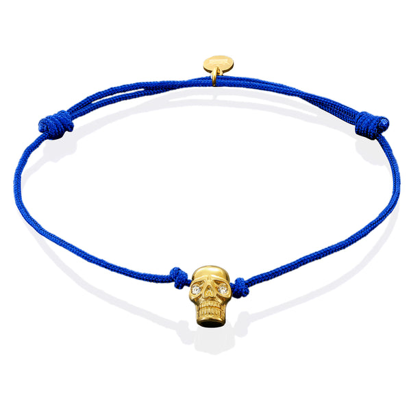 Gold Plated Skull on Blue String Bracelet
