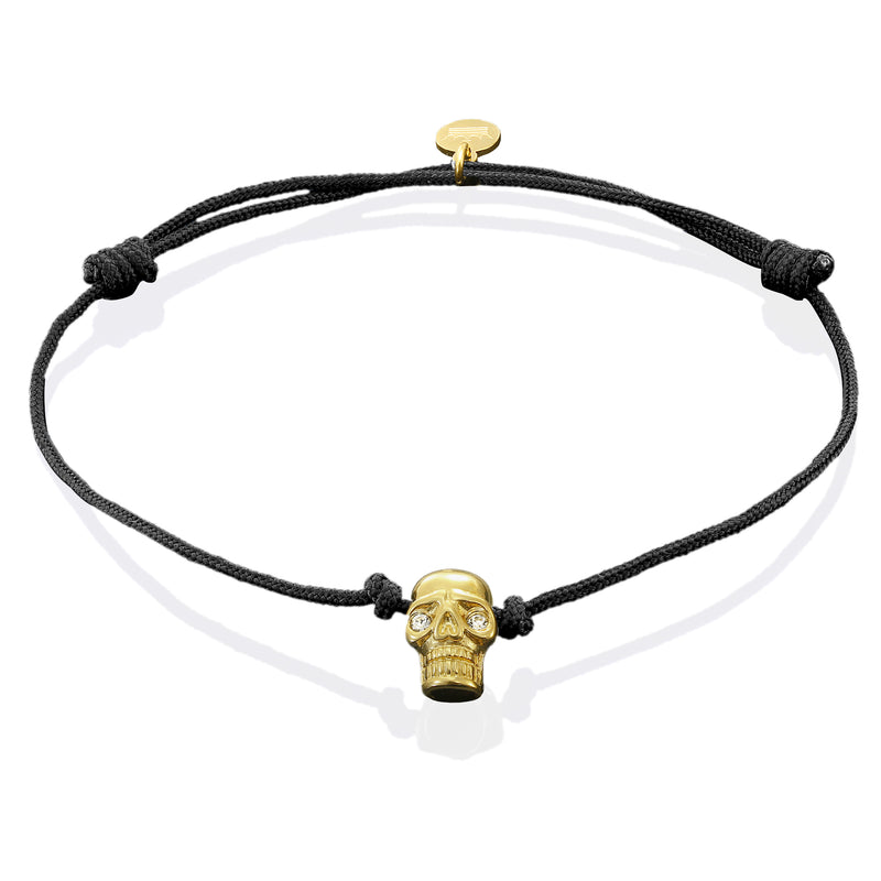 Gold Plated Skull on Black String Bracelet