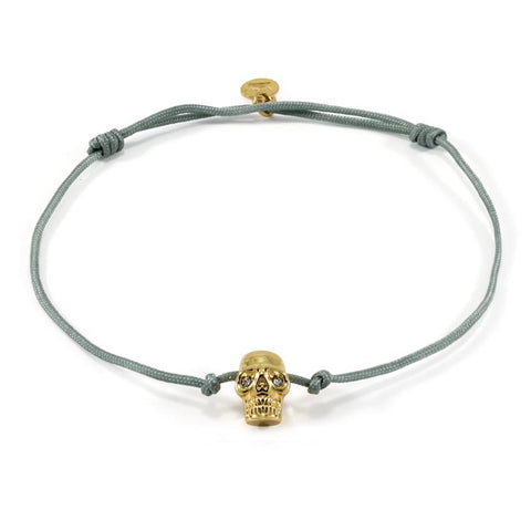Gold Plated Skull on Grey String Bracelet