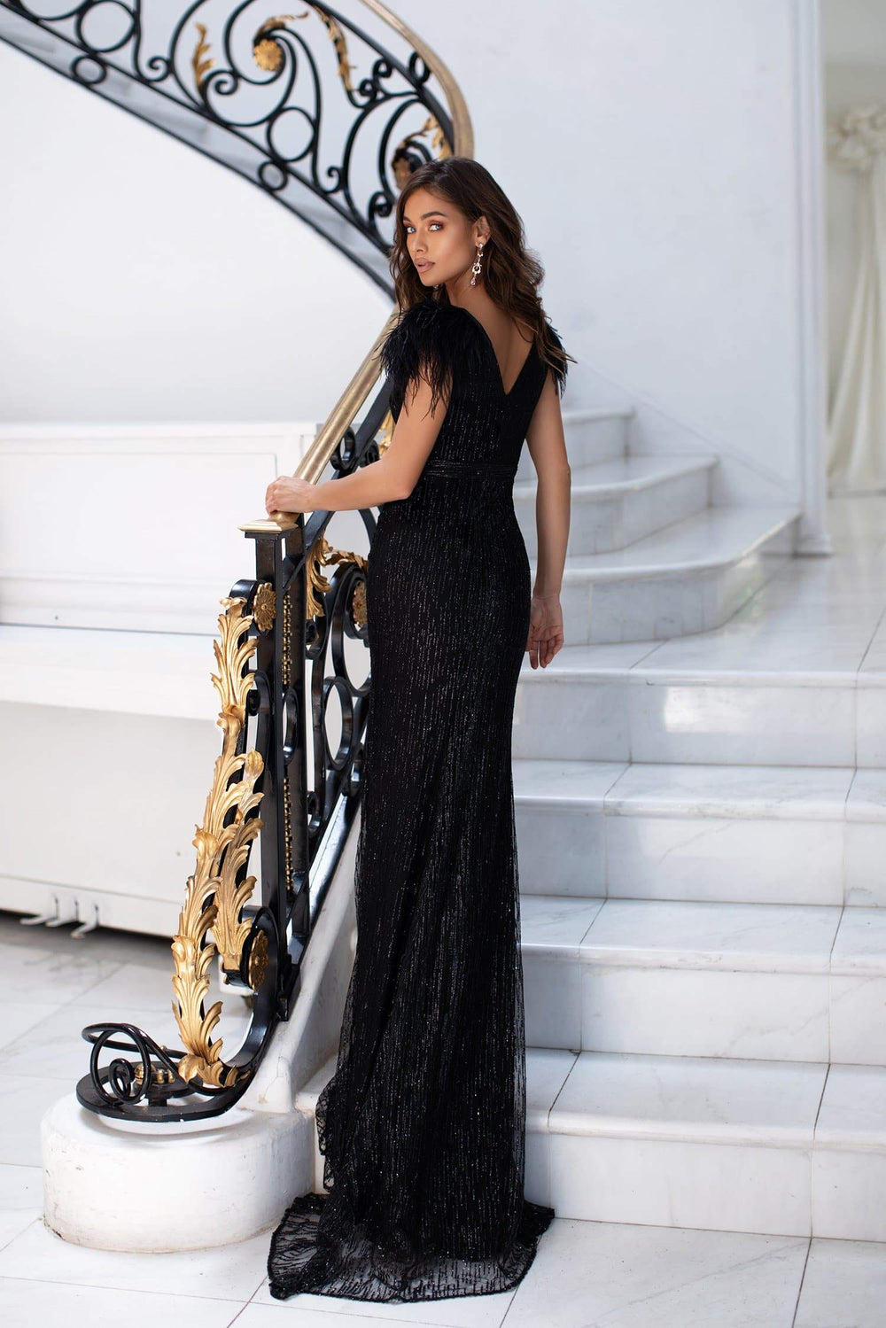 Elanur - Black Glitter Gown with Plunge Neck & Faux Feather Detail