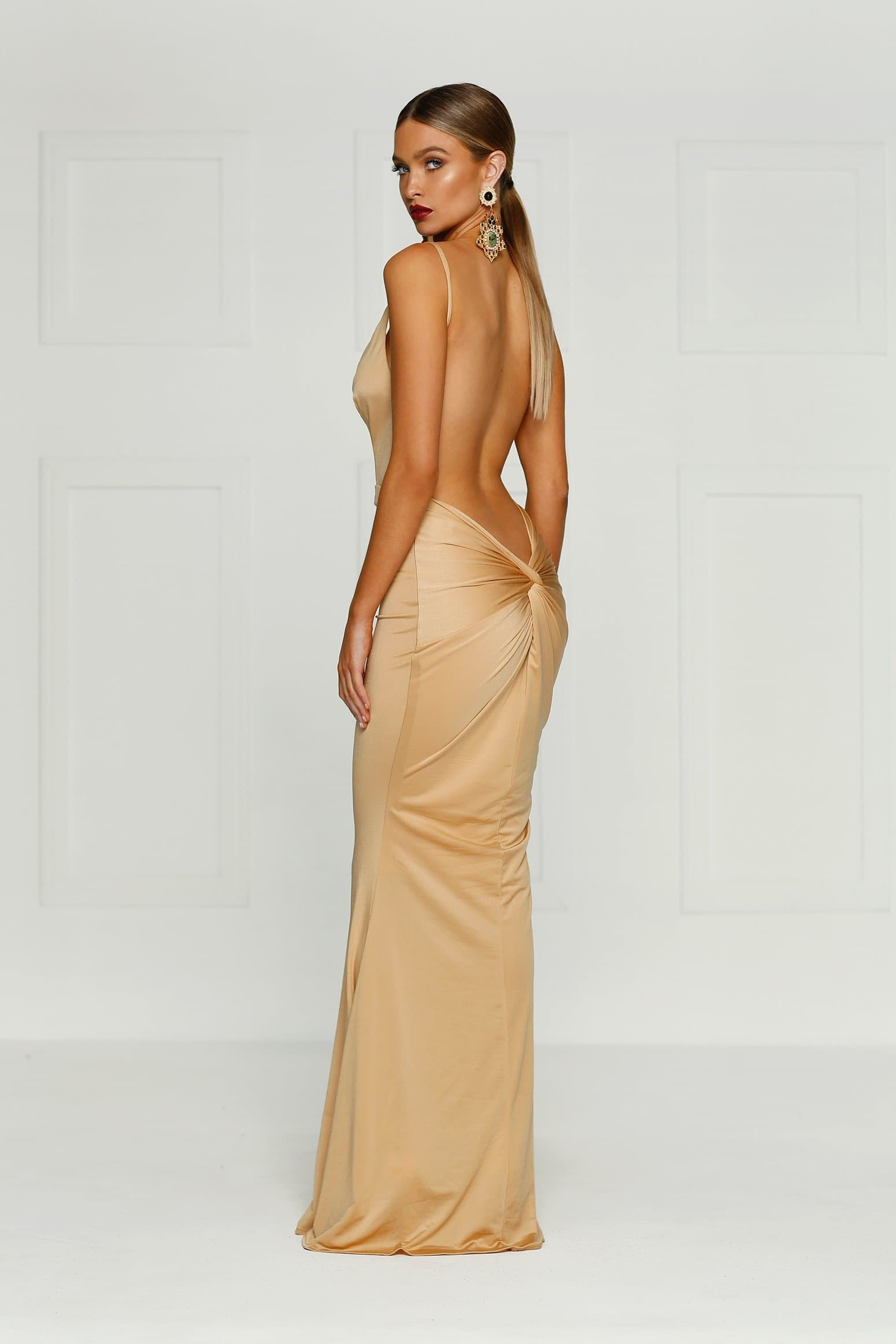 caramel backless dress with a plunging neckline in a stretch fabric. Fitted formal dress prom dress