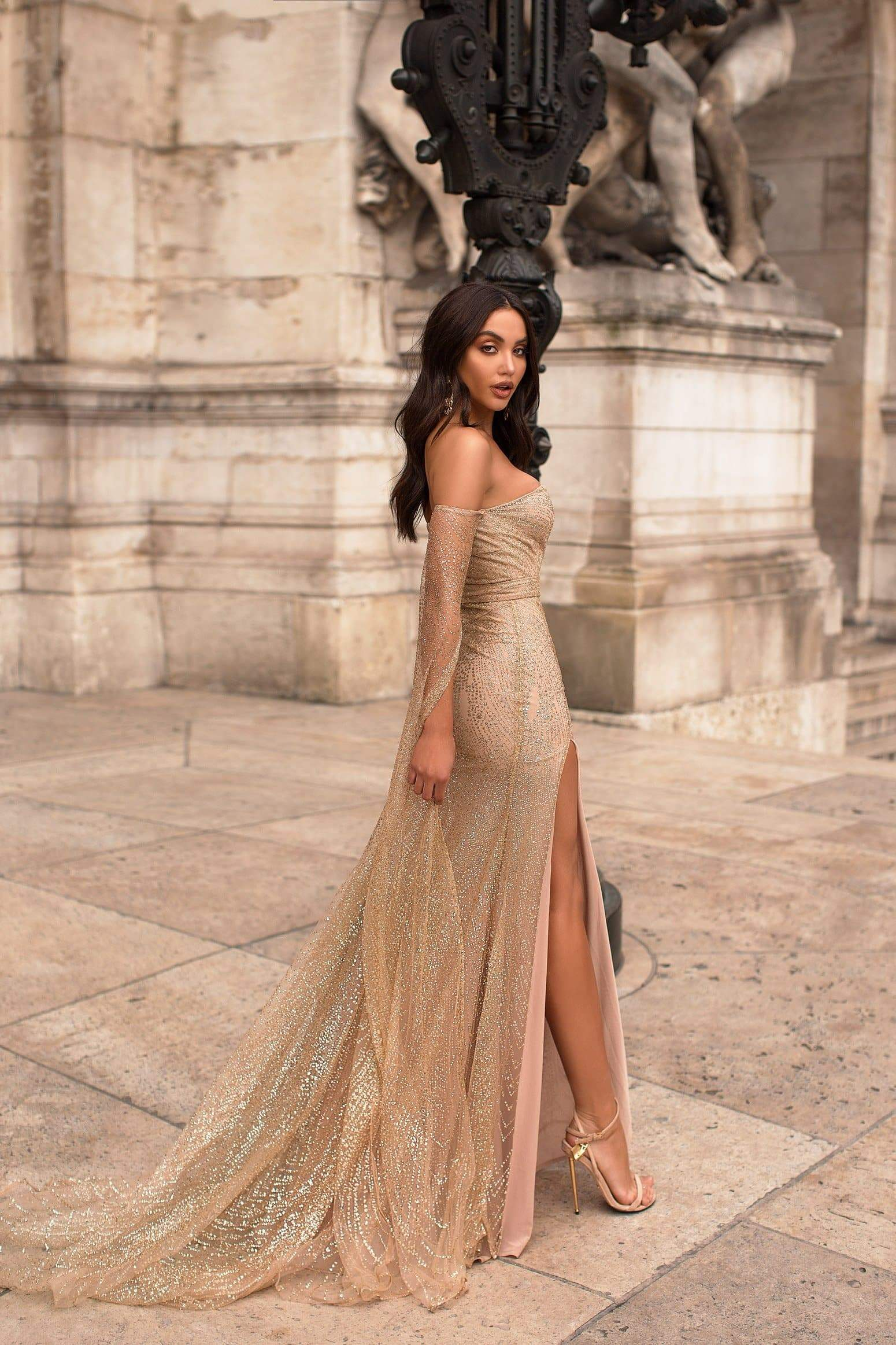 Jocelina - Gold Glitter Gown | Long Off-Shoulder Sleeves & Side Slit