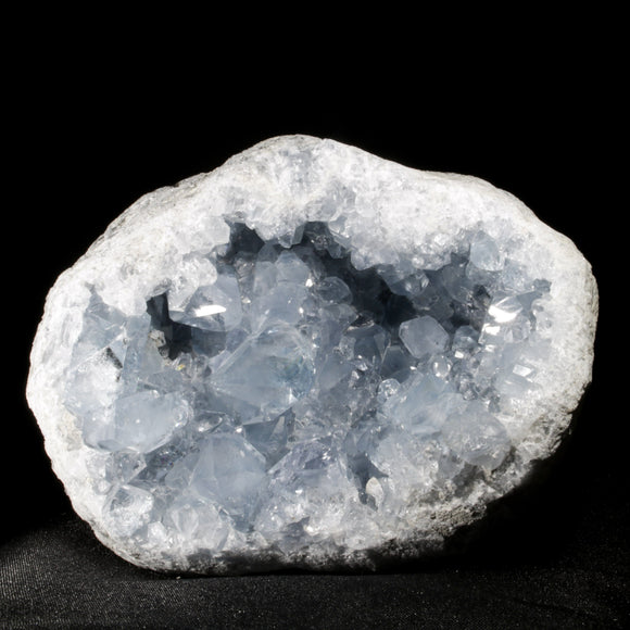 A 9 + pound Gemmy, Icy Geode of Celestite.  A massive, deep ice blue geode of gemmy Celestite from Madagascar. At over 9 pounds this statement piece covered in terminated, light blue crystals will command any space it inhabits.  8