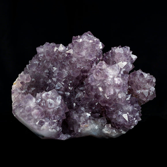 Amethyst Purple Color Crystal Natural Mineral Specimen # B 4092  https://www.superbminerals.us/products/amethyst-purple-color-crystal-natural-mineral-specimen-b-4092  Features:A very large Geode fragment lined with black bubbled  Chalcedony, partially coated with a sparkling colorless Chalcedony druse. There is another, smaller bubuled crystal near a corner, but it's the pristine, centered that steals the show! The luster, contrast, crystal formation and balance is outstanding