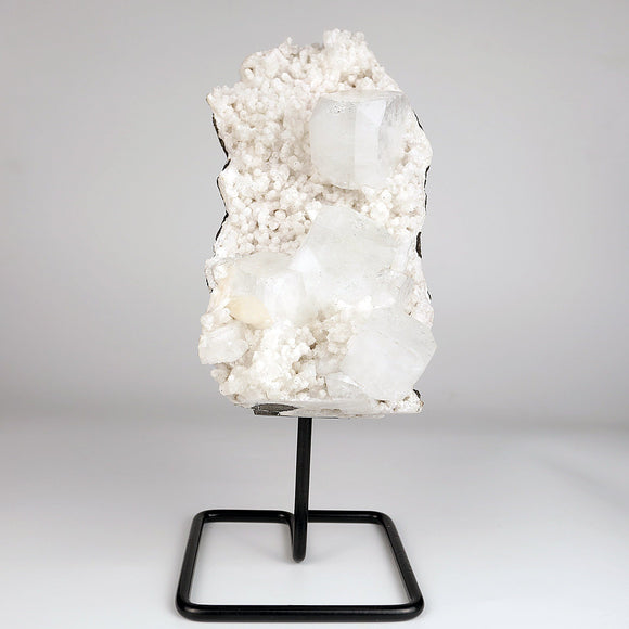 Apophyllite Big Cube on Chalcedony W/Stand Natural Mineral # DRL-198  https://www.superbminerals.us/products/apophyllite-big-cube-on-chalcedony-w-stand-natural-mineral-drl-198  FeaturesThis is a nice specimen of colorless Apophyllite crystals that formed in association with chalcedony, collected from Maharashtra, India. This stunning specimen includes the custom metal display stand shown in the photos. Primary Mineral(s):  Apophyllite