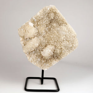Apophyllite with Chalcedony Plate With Stand # DRL-216  https://www.superbminerals.us/products/apophyllite-with-chalcedony-plate-with-stand-drl-216  Features :A very nice Chalccedony cast of a vug coated with minor apophyllite and apophyllites. Excellent conditionPrimary Mineral(s):  ApophylliteSecondary Mineral(s): N/AMatrix: Chalcedony18 cm x 19 cm2.290 Kgs Locality: Jalgaon, Maharashtra, India
