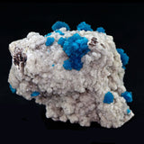 Cavansite Balls with Stilbite on Heulandite # E54 Blue cavansite puffs scattered and clustered a long matrix. 2. All side piece self standing. Small white stilbite blade inclusion. Primary Mineral(s): CavansiteSecondary Mineral(s): StilbiteMatrix: Heulandite7cm x 6cm X 6cm5.5 OzLocality: Pune