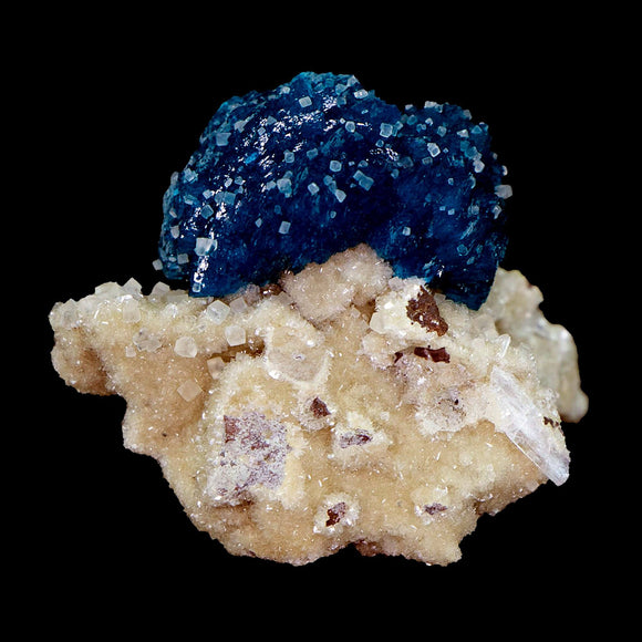 Cavansite Deep Blue with Calcite on Heulandite # E44 Tiny with tones going on. Deep blue cavansite surrounded and coated by tiny calcite cubes.  Primary Mineral(s): CavansiteSecondary Mineral(s): CalciteMatrix: Heulandite 4.5cm x 3.5cm X 3.2cm 1 OzLocality: Pune, Maharashtra, India