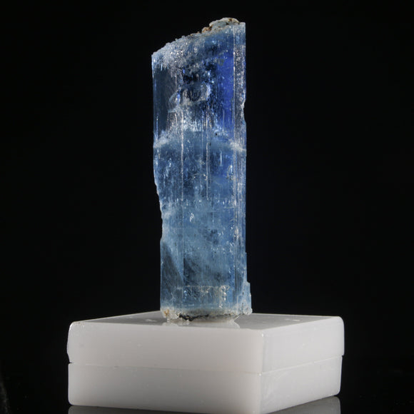 Deep Blue Aquamarine - 30+ carats. Thanh Hóa Province, Vietnam. A large crystal of gemmy, deep blue Aquamarine. Interesting contact features from adjacent crystal growth, transitional growth stages and exceptionally clean window faces make this a compelling piece. 30.4 carats, 35 mm x 19 mm