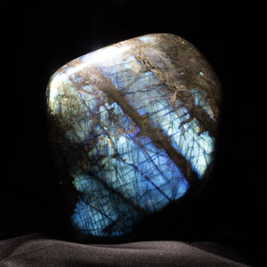 "Labradorite is a fascinating feldspar that exhibits its own property known as. . . .Labradorescence! It catches light and seems to shine from within. This large, freestanding Labradorite free form pops with electric color!  6"" x 6.5"" 6 lb. 10 oz."