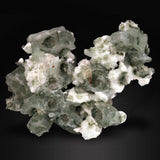 An excellent collector's specimen from a very limited, small water-well pocket find a tabular green Apophyllite with White Spheres of Mordenite. Ahmednagar, Maharashtra, India.  Apophyllite is a hydrated potassium calcium silicate and is a rarer form of Apophyllite in shades of green. It forms within clusters along with clear Apophyllite  and is often found in combination with other Zeolitic minerals such as Stilbite and Heulandite.  15 CMS X 10 CMS 220 GMS