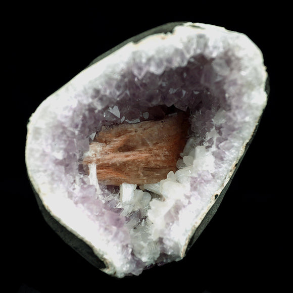 Heulandite, Stilbite Inside Amethyst Geode Natural Mineral Specimen # …  https://www.superbminerals.us/products/heulandite-stilbite-inside-amethyst-geode-natural-mineral-specimen-b-4028  Features:An aesthetic combination of quite light Amethyst with isolated brownish Apophyllite crystal inside Geode.  Primary Mineral(s): ApophylliteSecondary Mineral(s): AmethystMatrix: N/A7 cm x 10 cm590 GmsLocality: Aurangabad