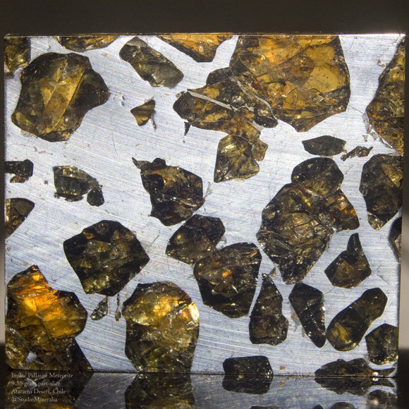 An expertly prepared 9.36 gram part-slice of the Meteorite, Imilac. 3 cm x 2.75 cm  Pallasite meteorites are the rarest of all types and consist of Iron and translucent crystalline Olivine (Peridot) that are theorized to have originated at the Core Mantle boundary of protoplanets destroyed during the formation of our solar system 4.6 billion years ago.