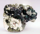 Marshy Apophyllite Green with Heulandite Natural Mineral Specimen # B …  https://www.superbminerals.us/products/marshy-apophyllite-green-with-heulandite-natural-mineral-specimen-b-3873  Features A very aesthetic specimen which has a flower shaped cluster of radiating marshy green apophyllite crystals occurring on a base of brown prismatic crystals of Apophylite.Green color of apophylite is due to inclusions of celadonite and whereas  brown color of the apophylite is the result of hematite
