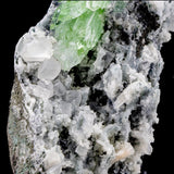 Multiple Deep Green Apophyllite Crystals with Few Calcite Cubes on Chalcedony  Features: 1. The color on the apophyllites is pristine. True green. 2. Clear calcite cubes appear throughout the specimen. Gorgeous. 3. A single stilbite blade formed on this specimen.