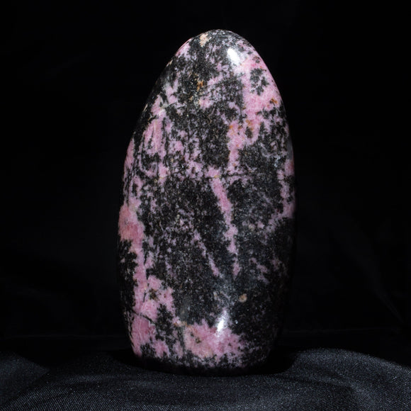 Pink & Black Rhodonite Free Form  An astonishing, contrasting piece of our planet. Deep gloss black swirls with pink Rhodonite in a perfect rounded tower presentation.  3.25