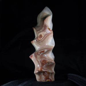 "Polychrome Agate Free Form  For those who require funky undulation. . . .a tall, free standing Ocean Jasper sculpture that casts a dramatic shadow.  A dramatic piece of the outdoors to bring inspiration indoors!  3.5"" x 9.5"" 3 lb. 13 oz."