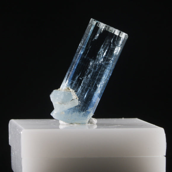 This 5.9 carat gemmy, tabular Aquamarine crystal terminates perfectly while the sidecar crystal growth provides a kick-stand. 5.9 carats, 6.5 mm x 19 mm