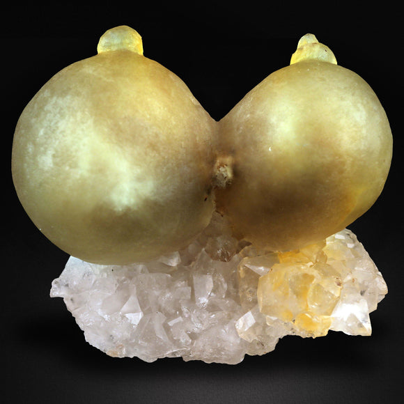 """NATURE'S CRAFTMANSHIP""  TWO YELLOW BOTRYOIDAL FLUORITE SPHERES.  THE ROUND OR SPHERE SHAPE IN GEOLOGY IS TERMED BOTRYOIDAL .  Amplify Energy Flow & Aid Mental Expansion  Fluorite cleanses and stabilizes the aura.  It absorbs and neutralises negative energy and stress.  An excellent learning aid, Fluorite increases our powers of concentration, self-confidence and helps us in decision-making.  It encourages positivity, balances the energies, and improves spiritual balance and coordination."