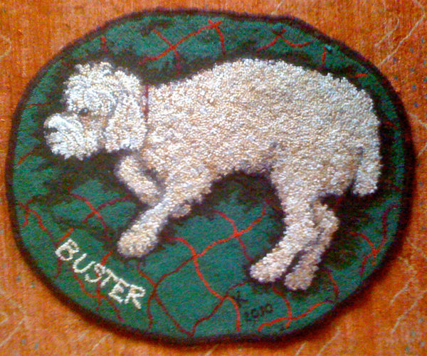 Buster. Designed and punched in the trompe l'oeil style by Kathleen Knisely, Somerville, Massachusetts.