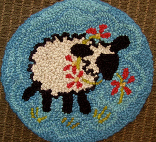 Circular lamb rug by Cindy Nordin