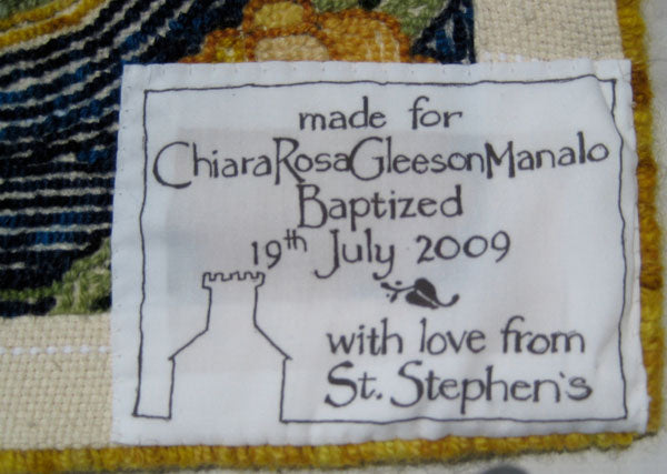 This label was made especially for Chiara's rug by parishioner and artist Ceil Murdoch.