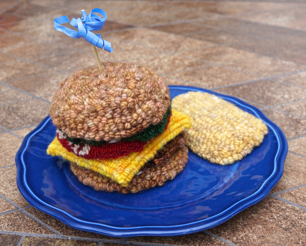 Punched Cheeseburger on a plate