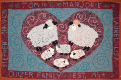 Duzier Family Est 1964. Designed and made by Marjorie Duizer.  This piece incorporates both punching with yarn  and hooking with a rug hook and strips of fabric. Click to enlarge