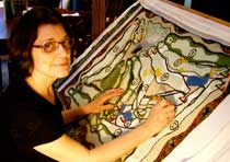 Elizabeth Millard. The rug I'm working on here is a  map of my family's favorite golf course.