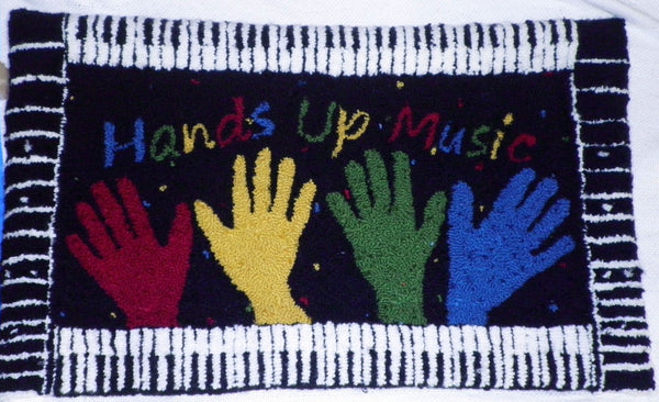 Hands Up Music Pillow. Designed and punched by Nancy Reams, Chippewa Falls, Wisconsin.