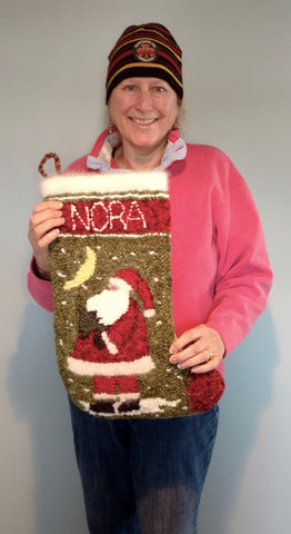 Bunny Lavallee and her Santa stocking for her newborn granddaughter Nora.