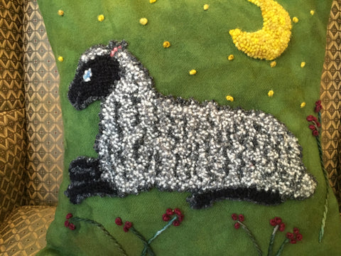 Pillow with Sheep design punched with wool yarn on wool fabric.