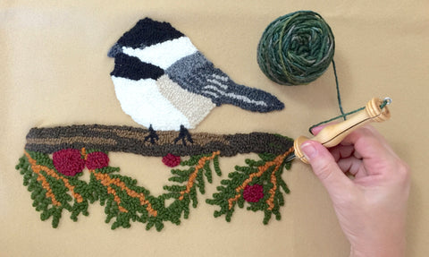 Chickadee wool on wool project shown with hand punching on project with yarn and punch needle.