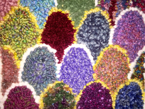Detail of texture in a rug made with knitting yarn