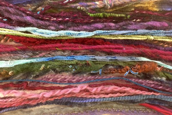 Strands of gorgeous knitting yarns to show texture.