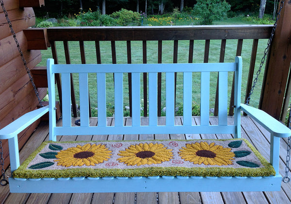 Sunflower Rug on a swing. Designed and punched by Irma Higgins, Ripton, Vermont.