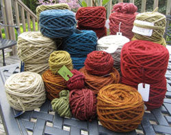 Sandra's hand dyed these yarns for her Pomegranate rug.